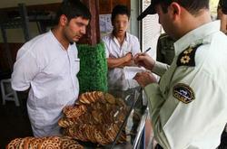 محكمة إيرانية تحكم بحرق فم رجل مسيحى أكل في نهار رمضان