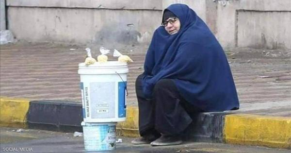"""""""سيدة المطر"""".. قصة صورة شغلت المصريين"""
