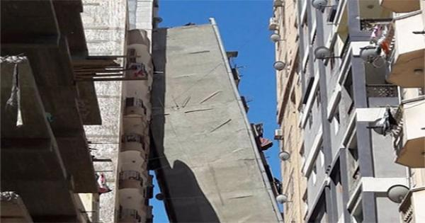 إحالة 3 موظفين بالحي للمحاكمة التأديبية في واقعة برج الإسكندرية المائل